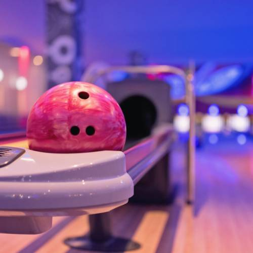 Young asian teenager holding bowling ball,bowling shoes and ball for bowling game,relaxing concept.